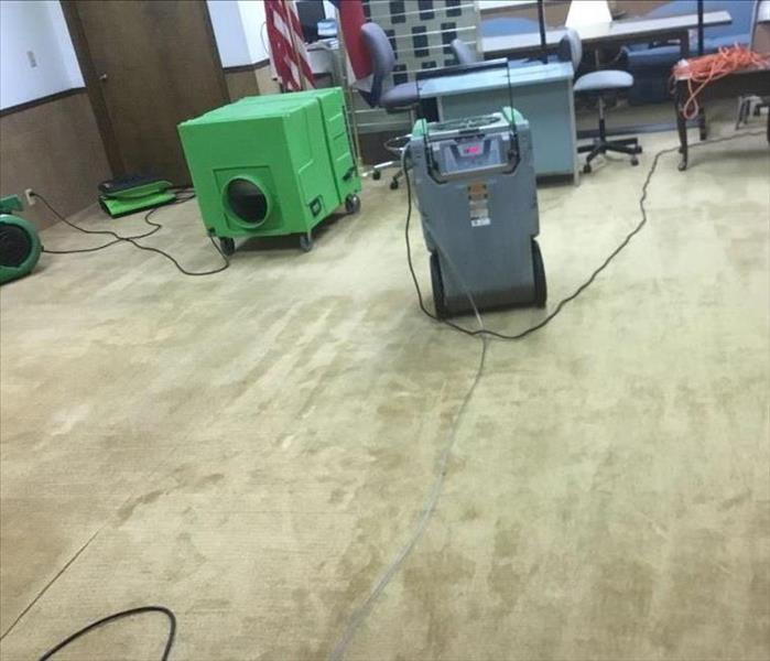 Water extracted from floor on carpets and equipment is set.