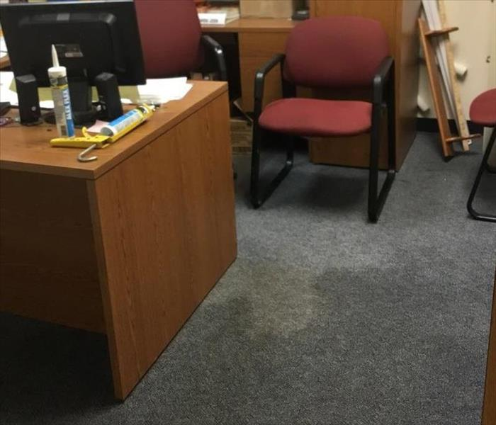 Office with water damage on the carpet
