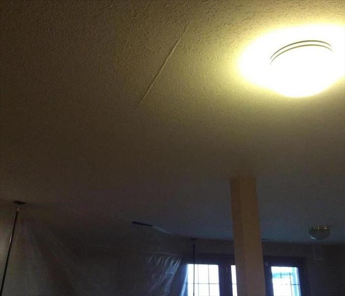 Ceiling with water damage with a containment below