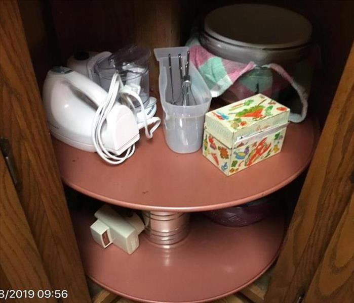 Restored Lazy Susan with clean kitchen items stored