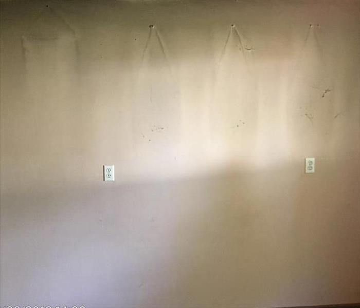 Wall with smoke damage with outlines of pictures